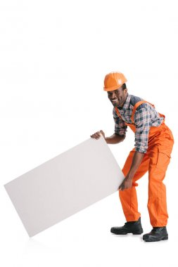 Handsome african-american builder with blank white banner isolated on white stock vector
