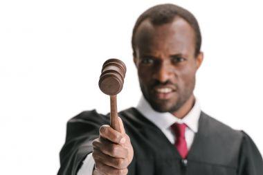 judge pointing at camera with gavel