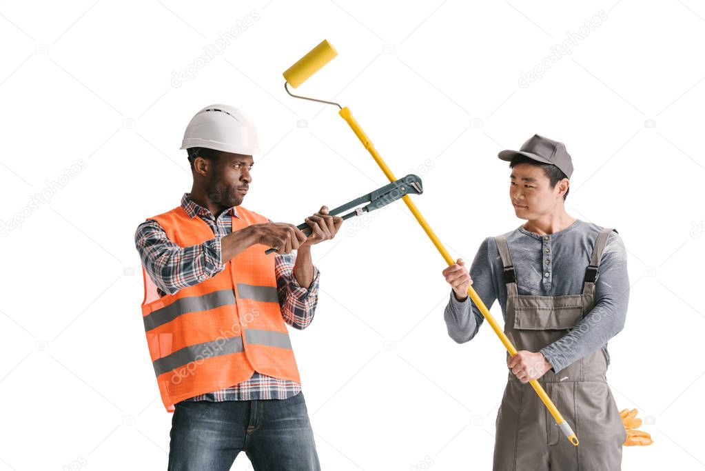 construction workers fighting with tools