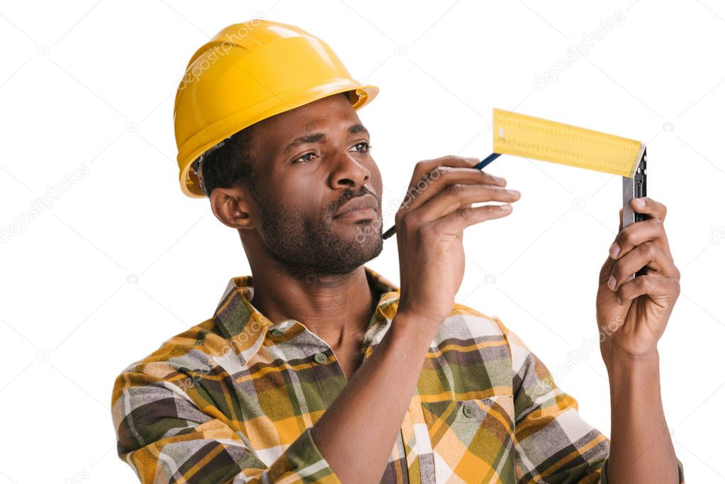 focused builder with measuring tool