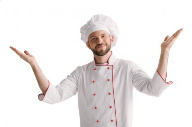 Young chef with raised hands