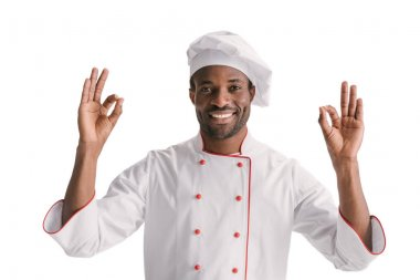 Happy african-american chef showing okay signs isolated on white stock vector