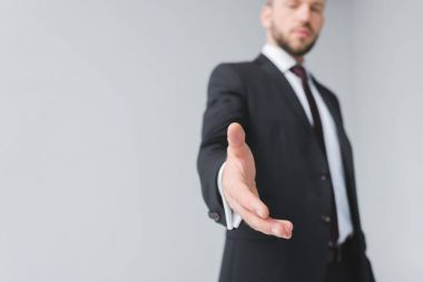 businessman with outstretched hand