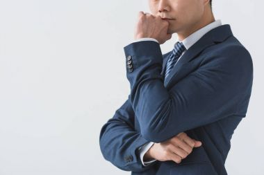 Pensive asian businessman