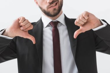 businessman showing thumbs down