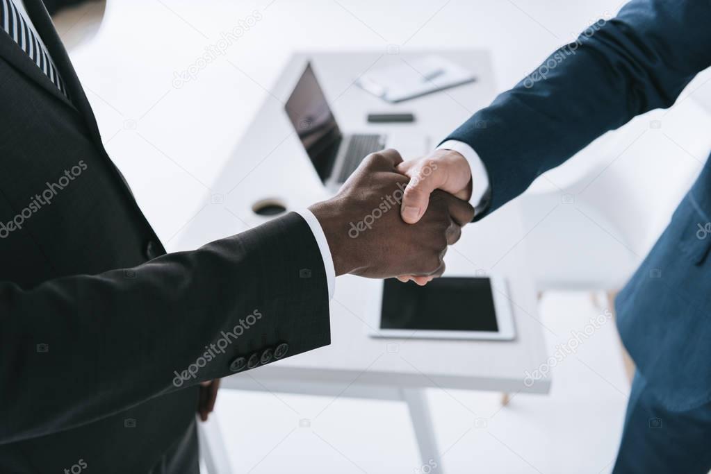 multicultural businessmen handshake