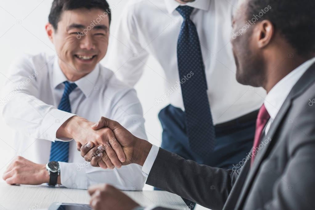 multiethnic businessmen shaking hands