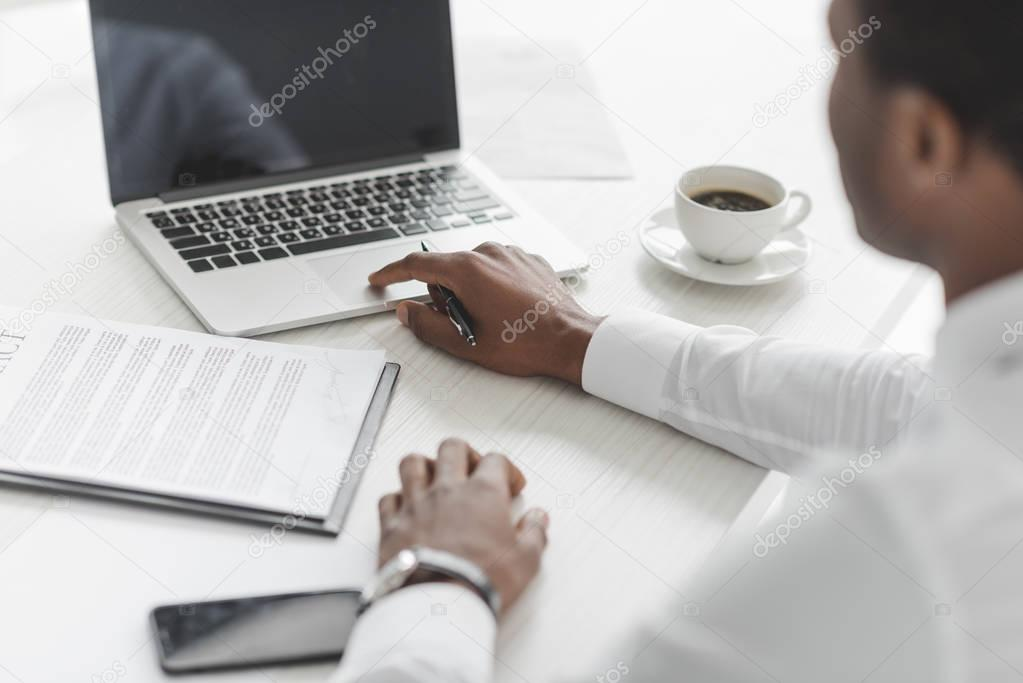 african american businessman working on laptop