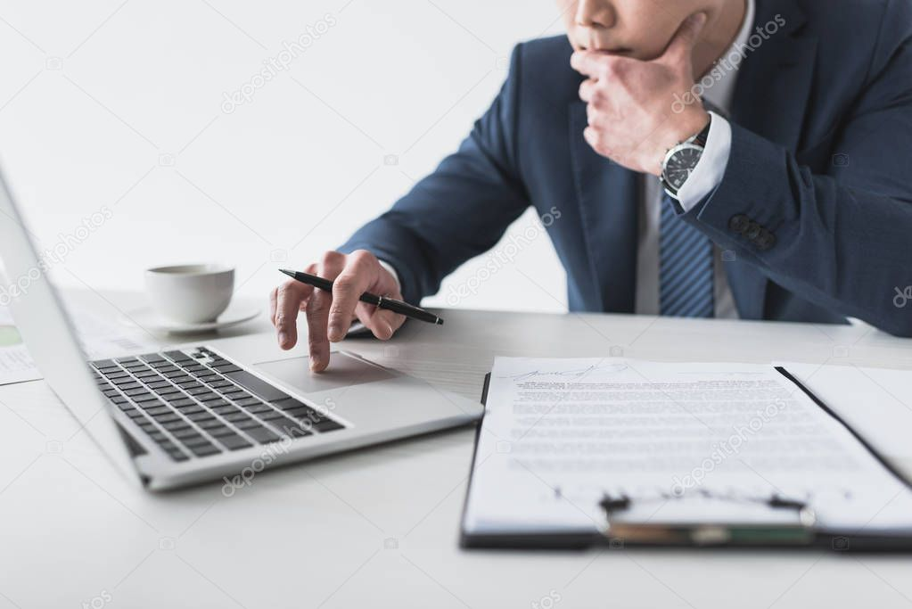 businessman with laptop at workplace