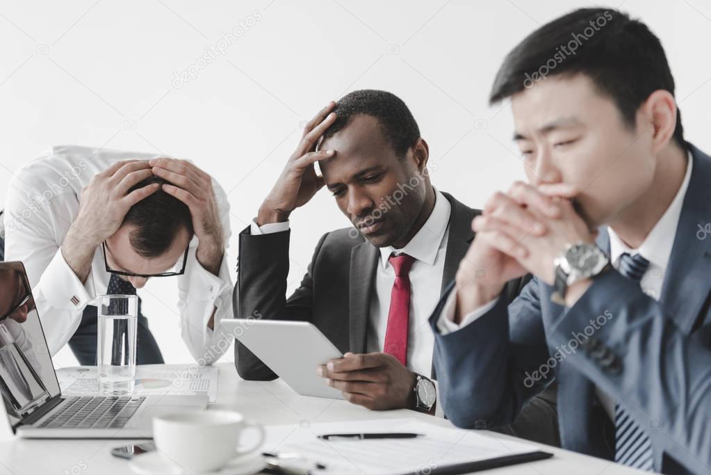 multicultural businessmen using tablet