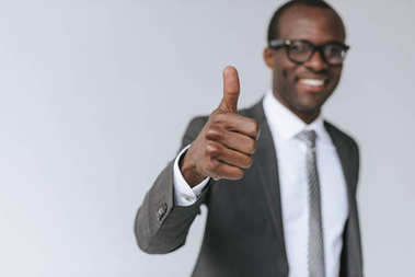 African american businessman showing thumb up