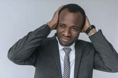 african american businessman having headache