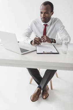 african american businessman at workplace with document