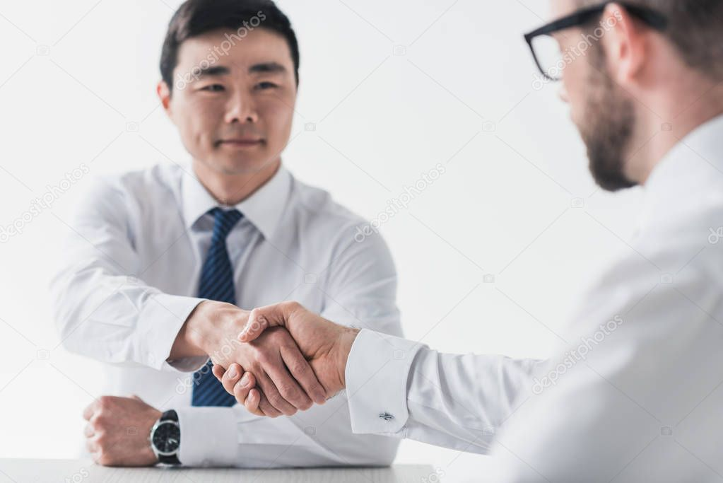 multicultural businessmen shaking hands on meeting