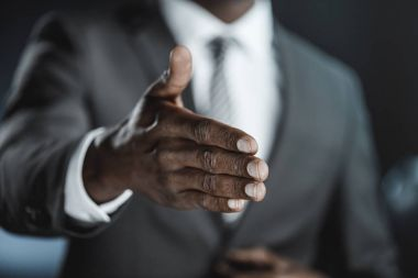 african american businessman with outstretched hand
