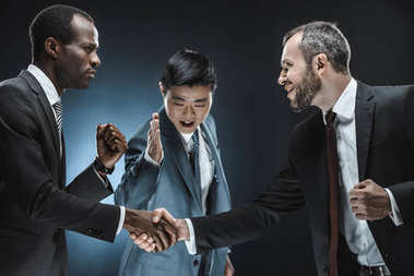 multiethnic business partners shaking hands