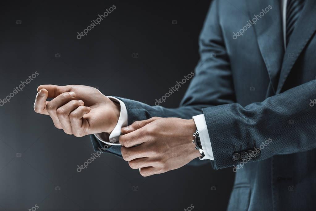 businessman buttoning shirt