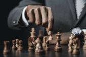 Fotografie afrikanische amerikanische Geschäftsmann Schach spielen