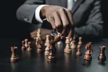 african american businessman playing chess