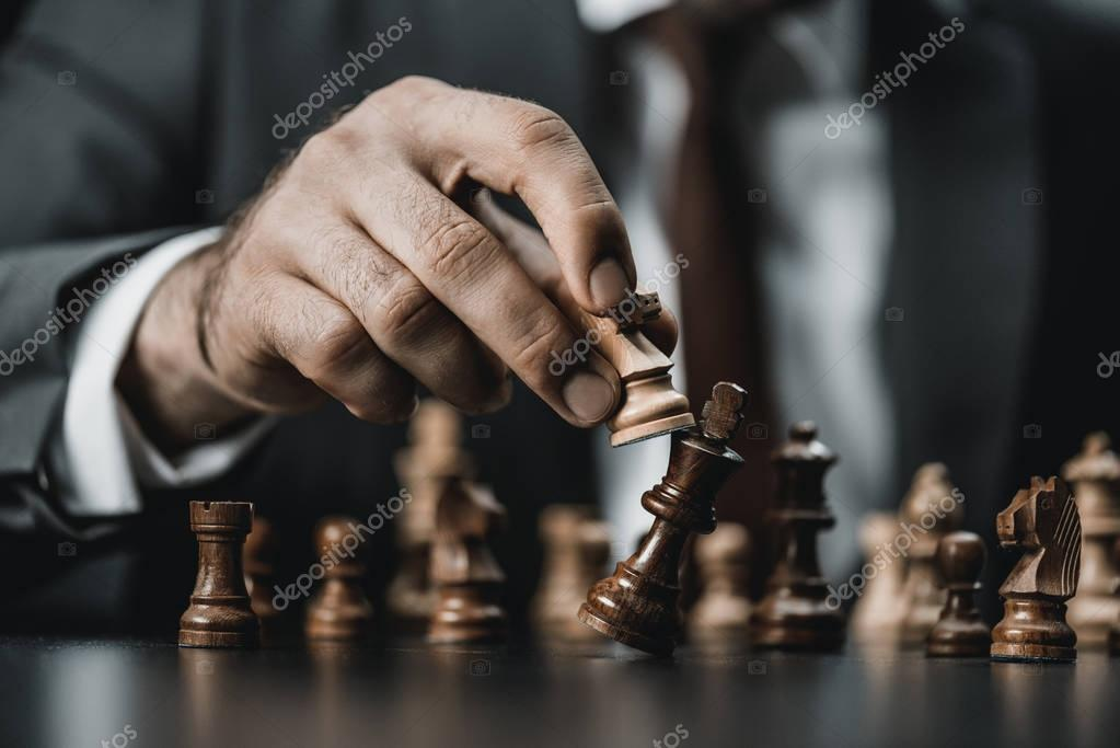 businessman and chess figures on table