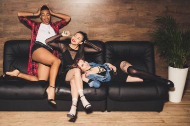 multicultural women on sofa