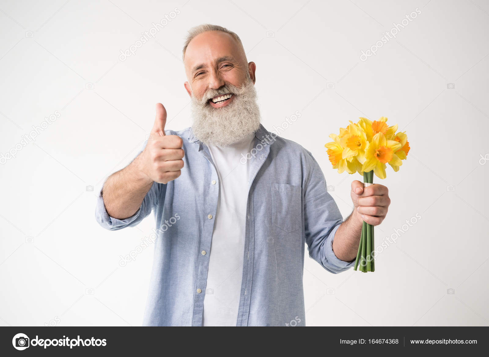 Man with flowers showing thumb up — Stock Photo