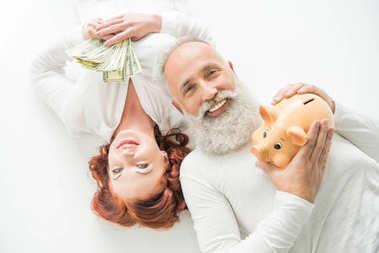 couple with dollars and piggy bank