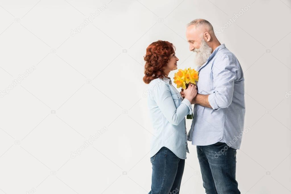 mature couple with bouquet