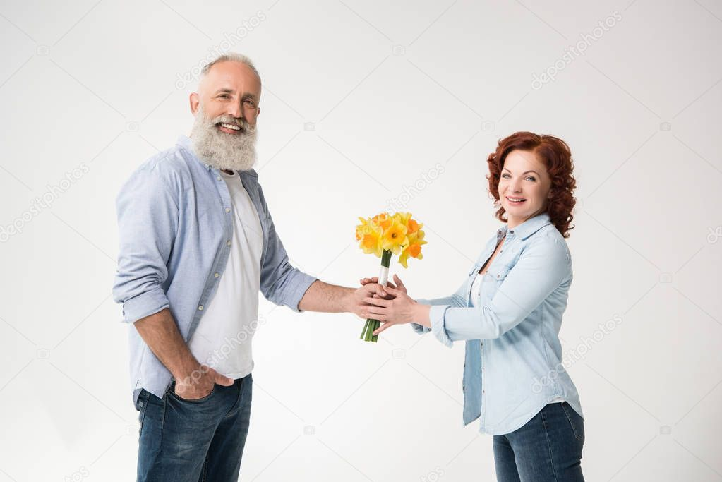 happy couple with bouquet