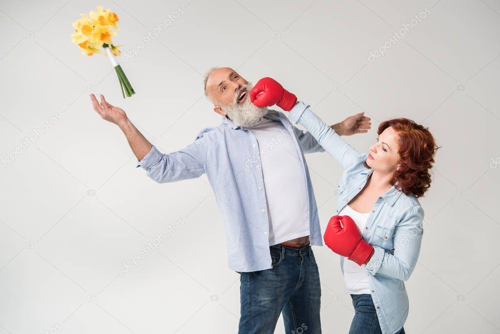 woman punching her husband