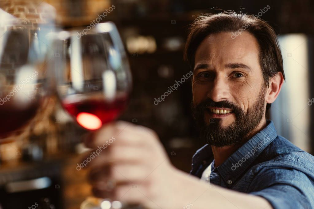 bearded man with wine glass