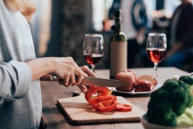 Woman cutting pepper