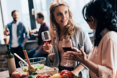 Female friends drinking wine