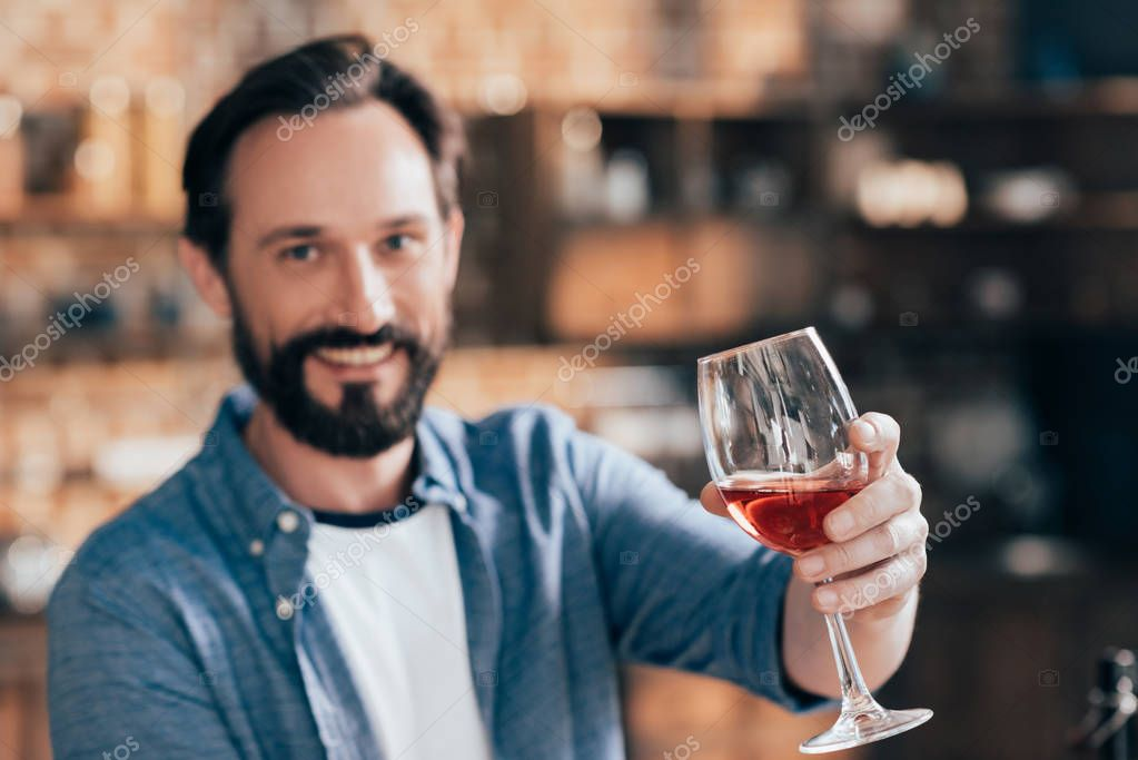 man holding wine glass