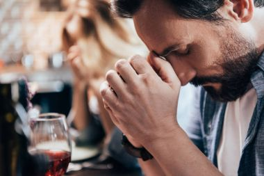 man praying before dinner
