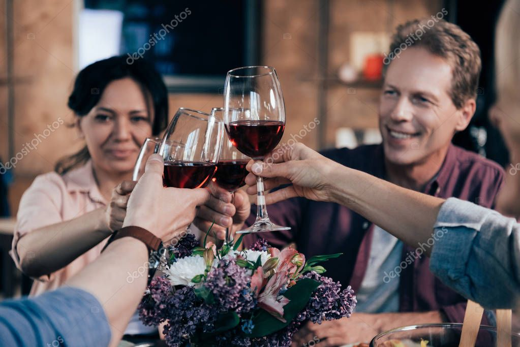 friends drinking wine at dinner
