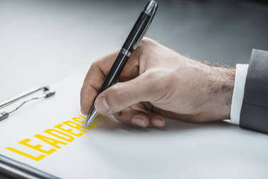 businessman writing business ideas on paper