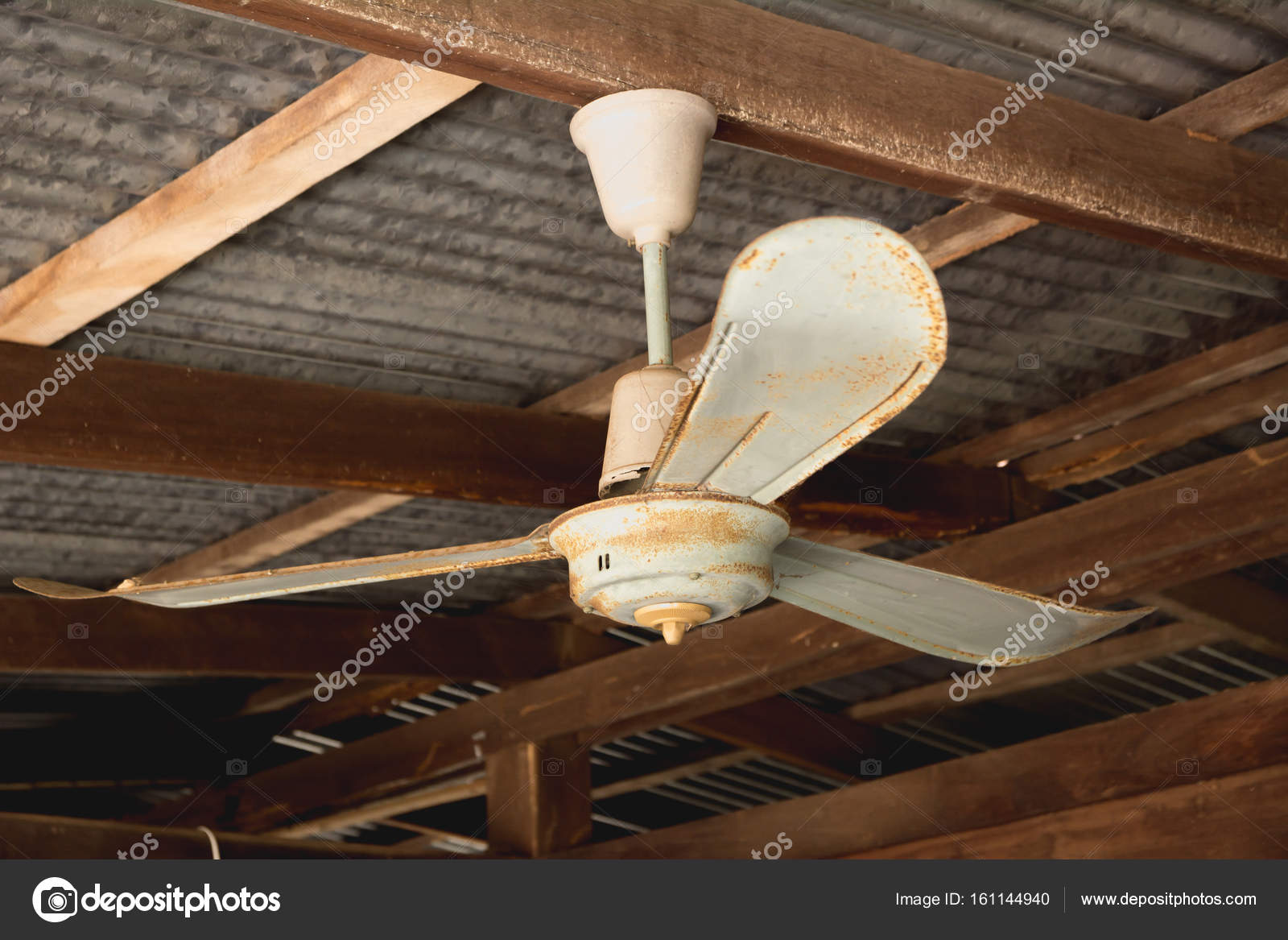 Electric Ceiling Fan Old Rusty Ceiling Fan On Rusty On Roof In Old House Stock Photo C Krisana Antharith Hotmail Com 161144940