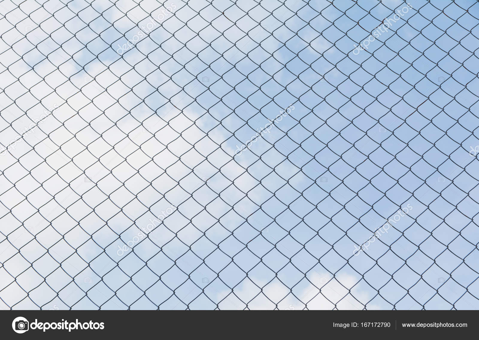 Rusty chain link fence under the sky background Abstract closeup of