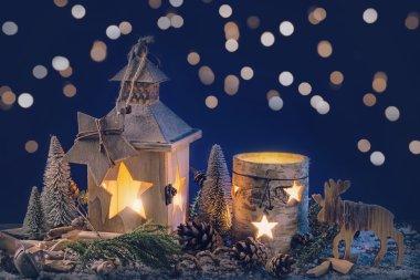 Burning lantern and christmas decoration