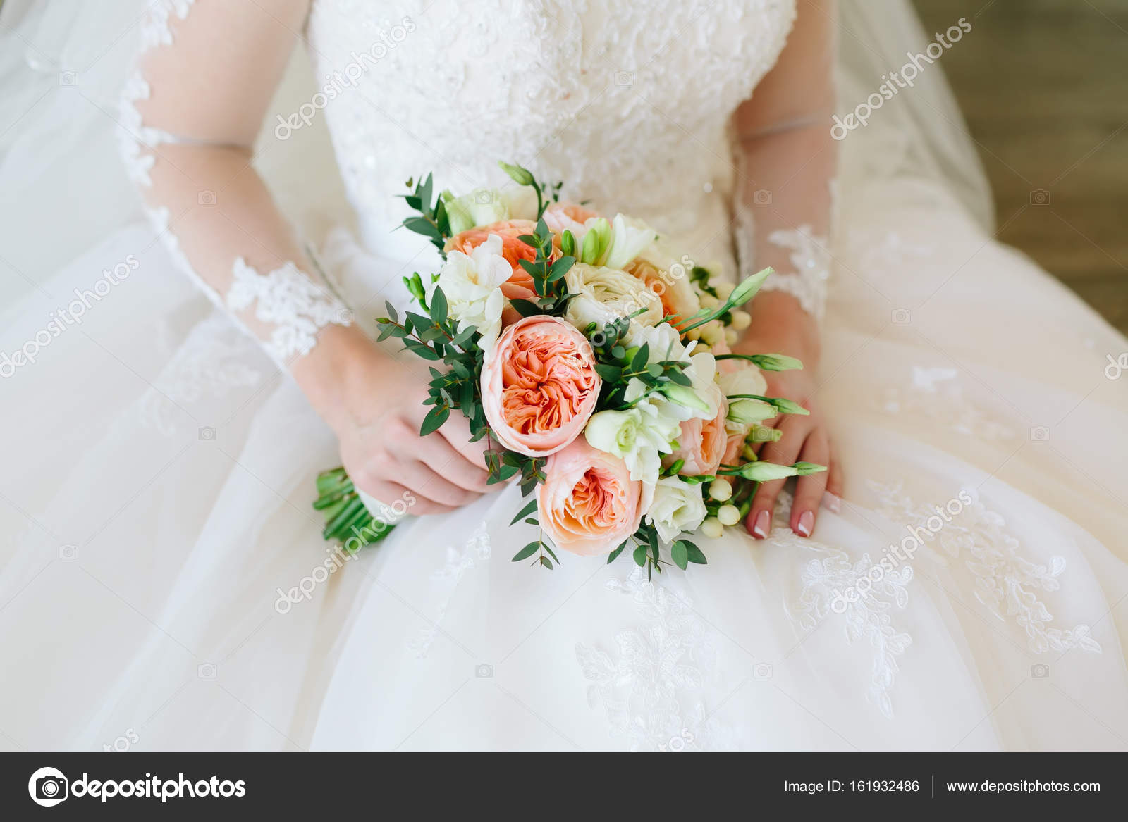 Gorgeous Bouquet Of White And Orange Flowers In The Hands Of The