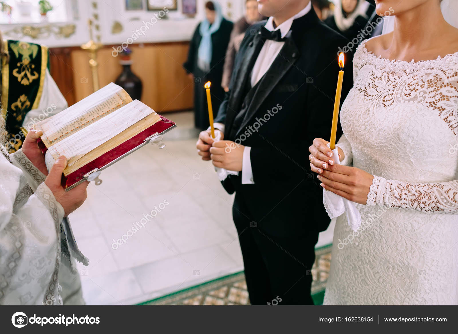 Unrecognizable bride and groom in the church during the Christian ...