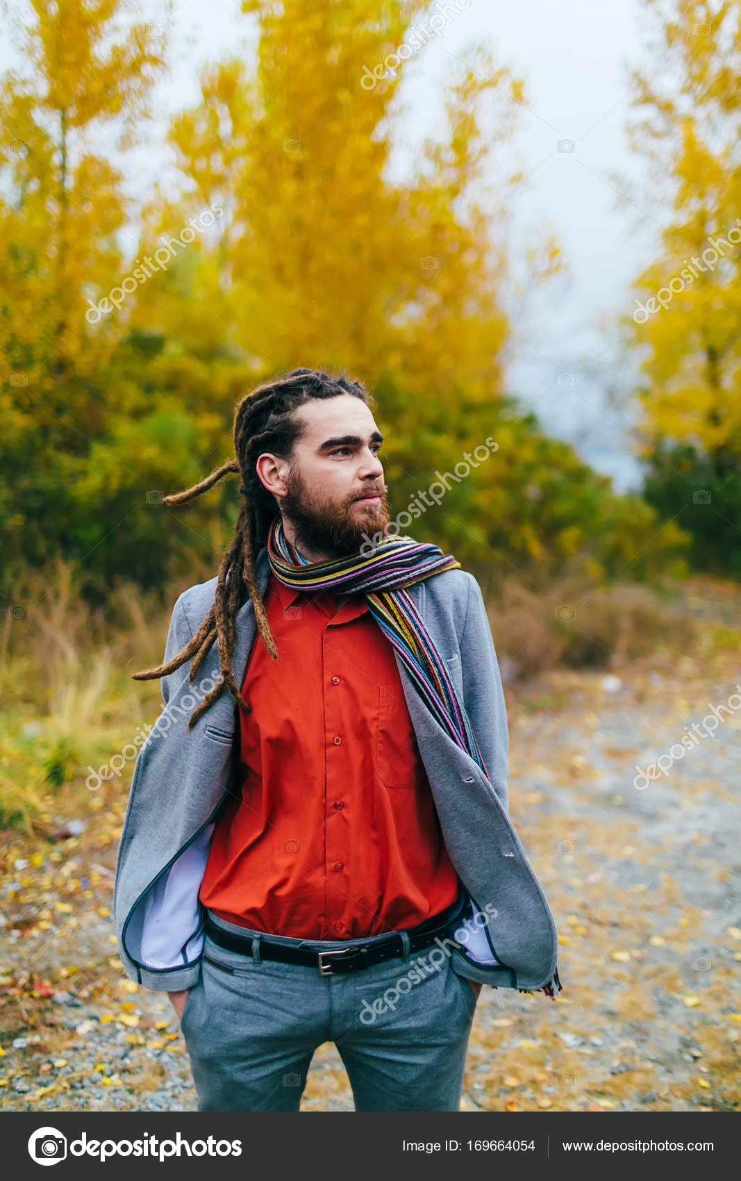 Hipster  A stylish man with dreadlocks and beard in a red
