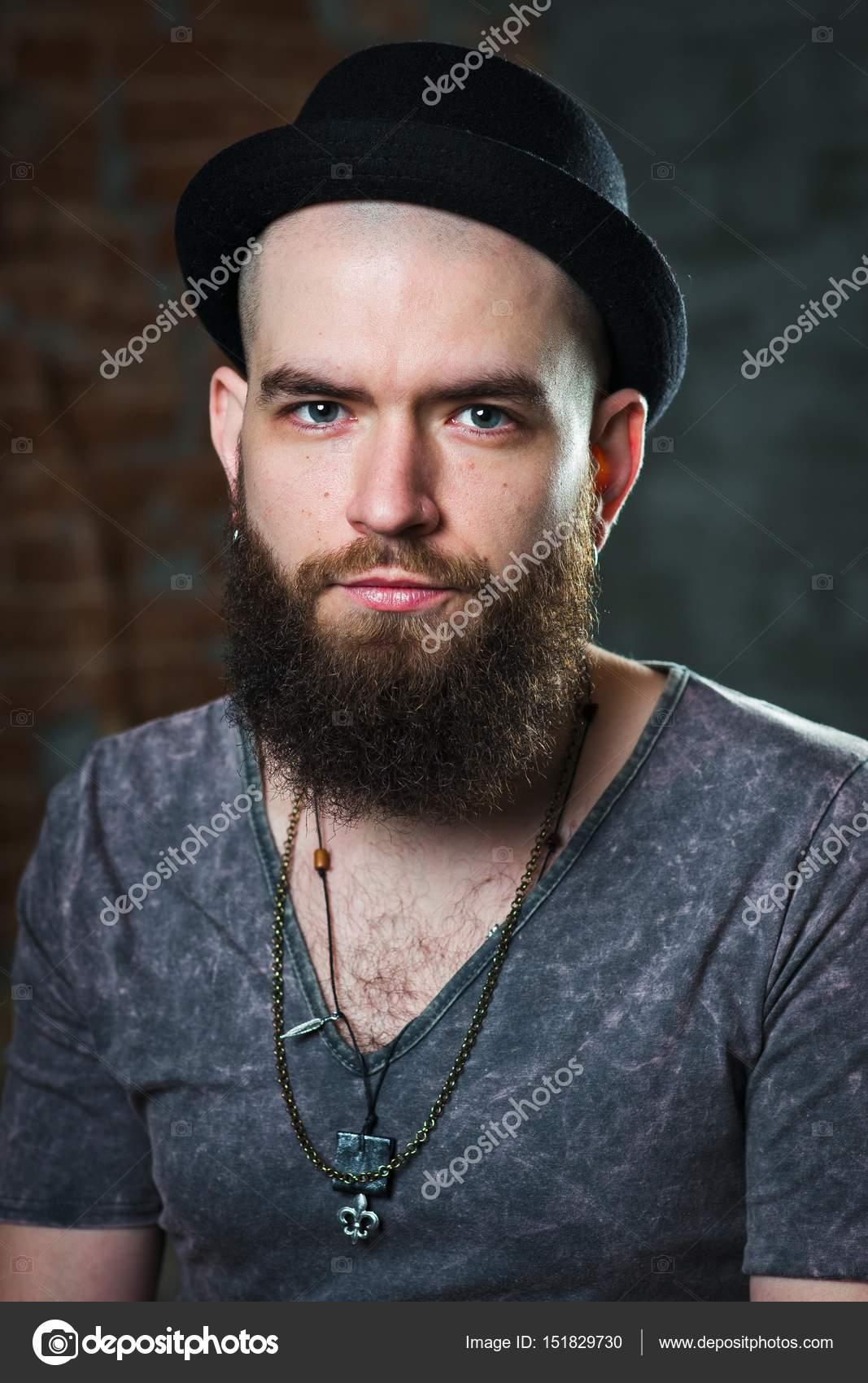 portrait of a bearded guy in a hat cute bald guy with a beard