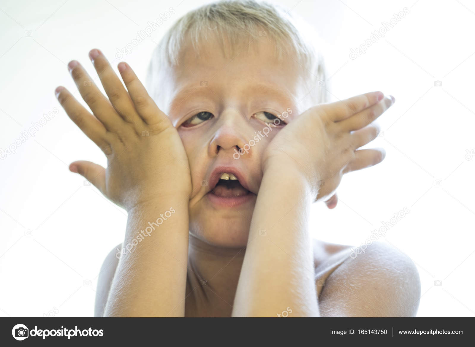 The angry face of a little boy  — Stock Photo © vazzzan