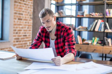 Male architect with blueprints