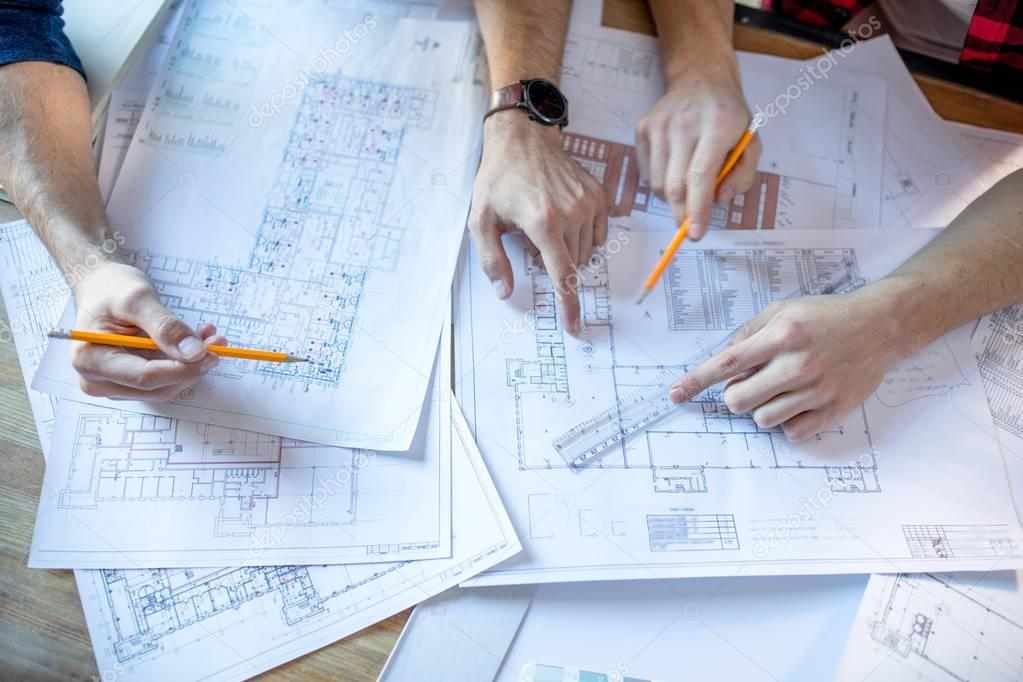 Architects discussing blueprints