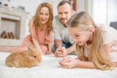Happy family with rabbit