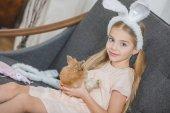 Photo Little girl with rabbit