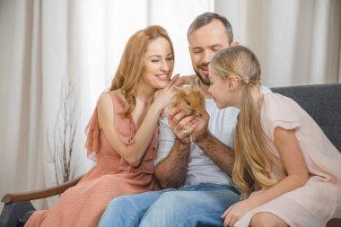 Happy family with rabbit